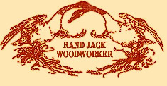 drawing of logo of two swans in natural unpainted wood with necks intertwined, titled Rand Jack, Woodworker