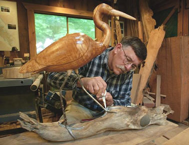 Bird carving studio, Rand Jack at work on one of his life size unpainted hardwood bird carvings